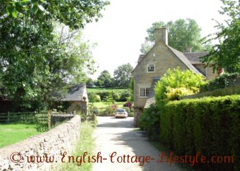 Cotswold stone cottage, wall and farm fence with hedges